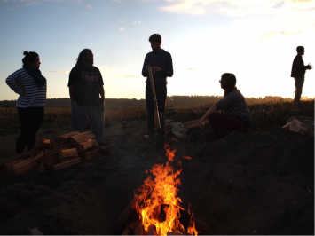 Young people from Aotearoa and Alba/Scotland worked together to prepare the pit-fire (photo – Robin Haig)