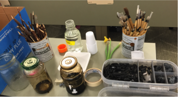 Figure 1: Walnut ink, bamboo brushes, sharpened twigs and charcoal used in the botanical art workshop in class (Photo Credit: VL Rodgers).